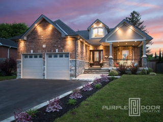 A photo of a custom home taken at twilight