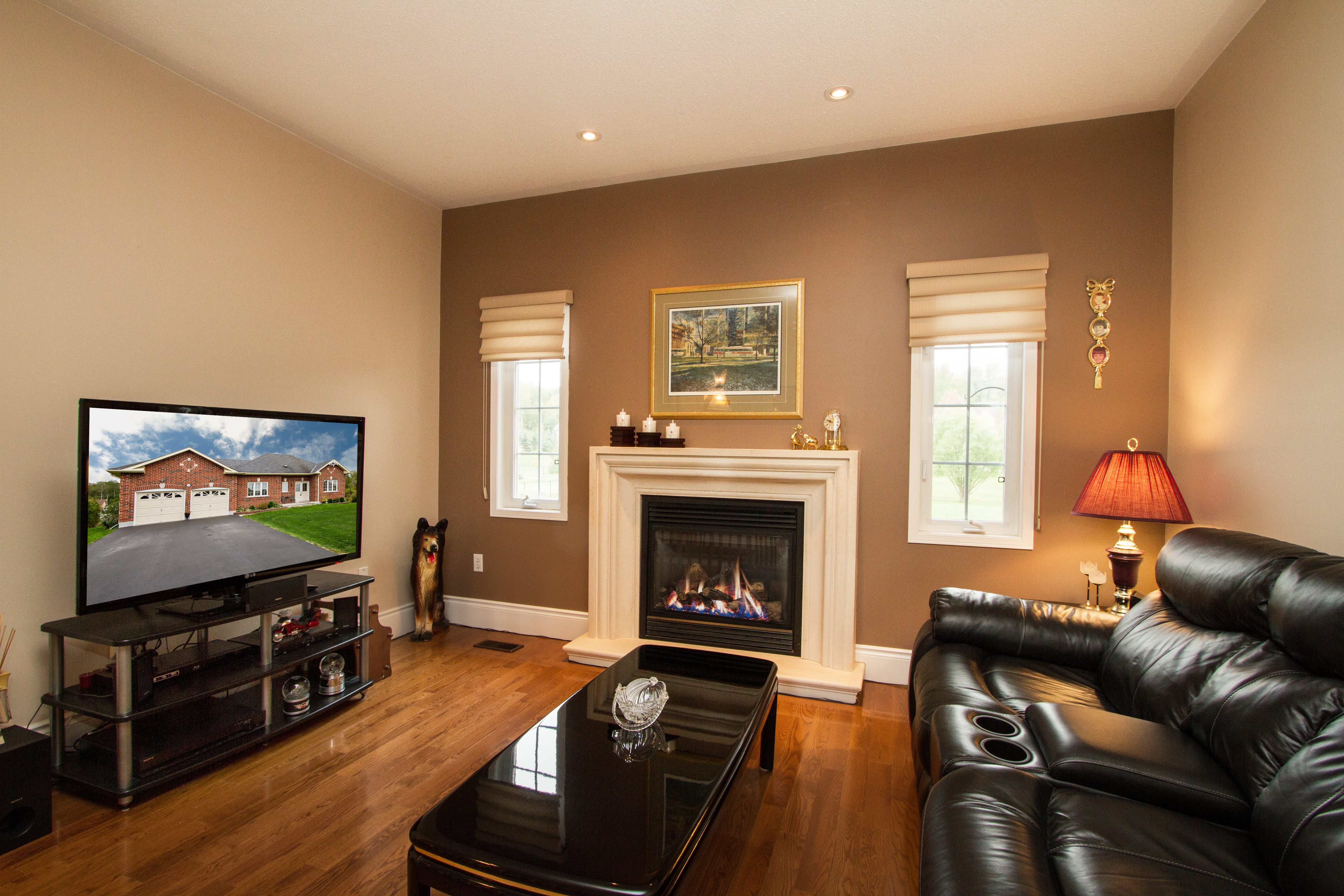 A photo of a formal living room with a gas fireplace by Purple Door Creative