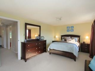 Photo of a master bedroom by Paula Kennedy of Purple Door Creative