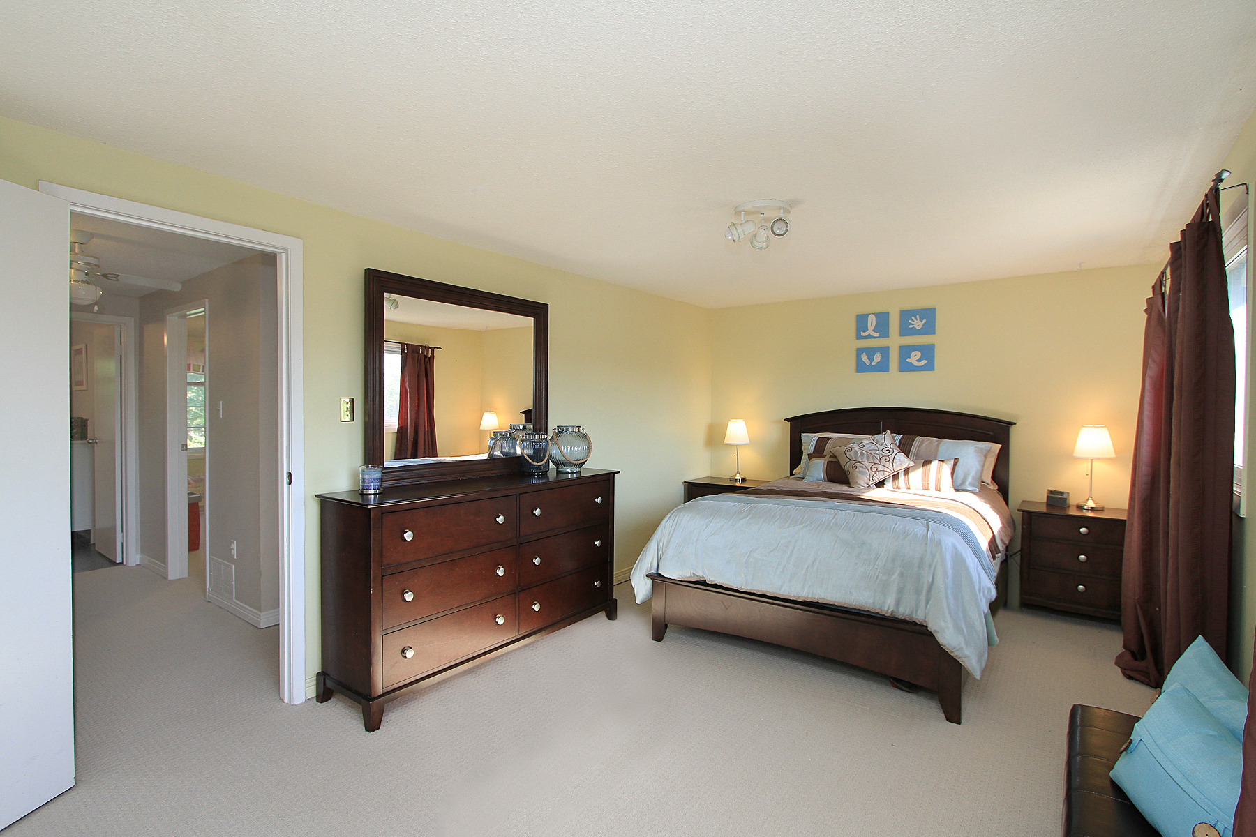 Photo of a master bedroom by Paula Kennedy of Purple Door Creative